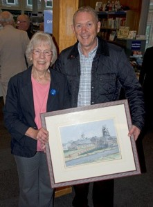 Shirley Moore receiving a picture of Thoresby Colliery on behalf of Edwinstowe Historical Society from David Betts former Colliery Manager